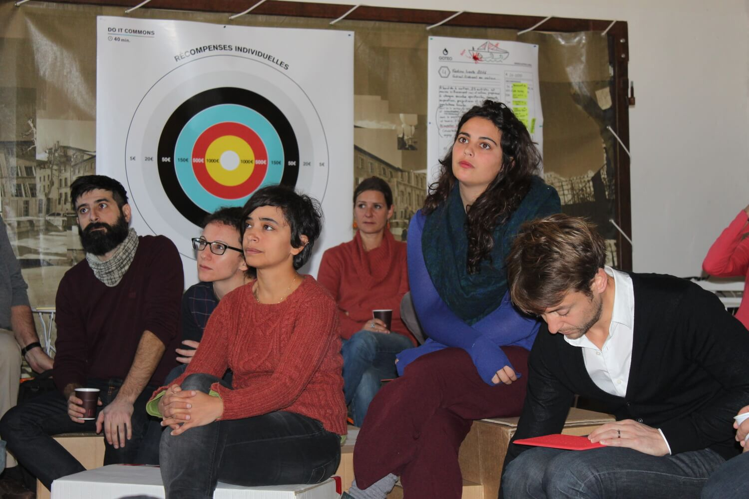 Participants during the presentation by Goteo