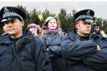 "Rebel clown army confronts the G8 Summit in Scotland. From ""Build the City."""