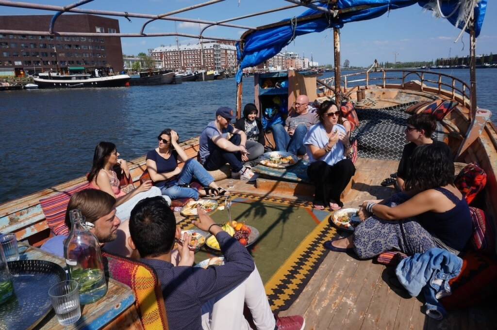 The Living Room took place on a boat in Amsterdam in April and May 2016. Photo via Migrationlab.org.
